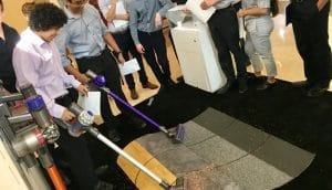 Customers trying out Dyson vacuum cleaners